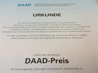 "You can see a certificate, which has written ""DAAD-Prize"" in bold letters on it."
